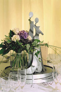 Little Ironies figurine table centrepieceswith flowers from Waow Studio